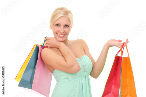 young happy woman with bags for shopping