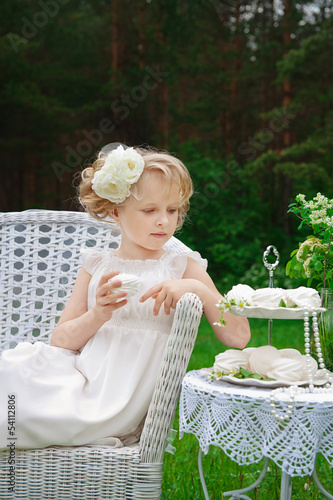 Beautiful little girl in white dress