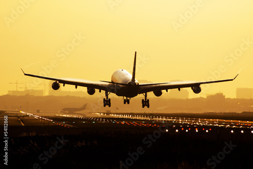 Airplane sunrise landing