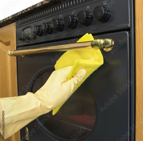 women arms only cleaning the outside of an oven