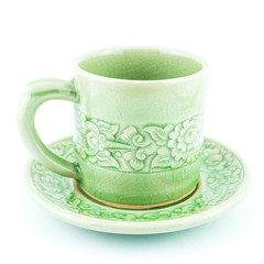 Green tea cup with flower pattern isolated on white background