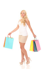 Shopaholic. picture of lovely woman with shopping bags.