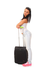 female standing with travel suitcase