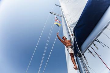 Handsome man on sailing ship
