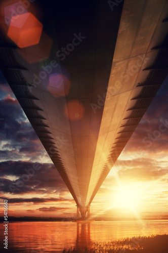 sunset under bridge