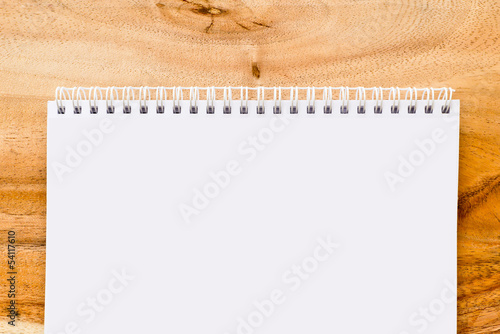 Open blank notebook on wood background