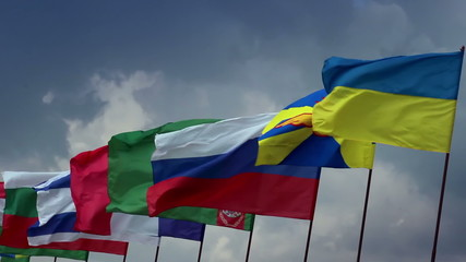 Many countries flags on flagpoles. Ukrainian, Russian, Turkmen
