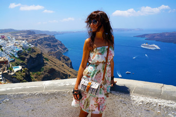 Happy young woman in a travel. Santorini