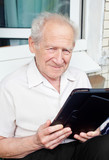 Senior Man With Tablet