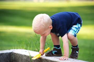 Cute little boy climbing a wall