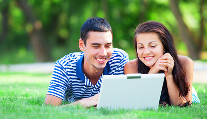 Students with laptop at outdoor