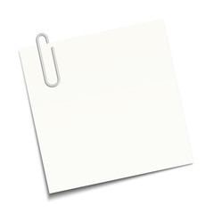 White sticky note clipped with a paperclip