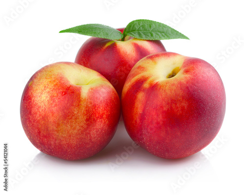 Three ripe peach (nectarine) fruits isolated