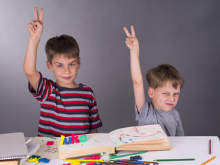 enthusiastic schoolboys raising their hands, education concept