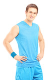 Smiling male athlete in sportswear posing
