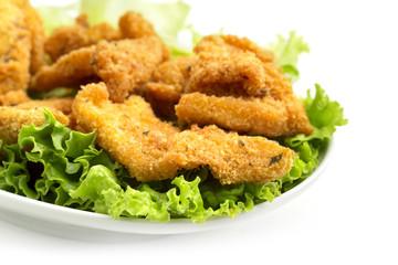 fried chicken on lettuce