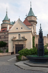 Magnificent castle Bojnice with fountain in the foreground