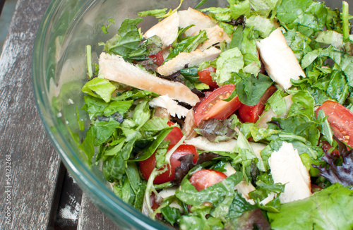 Healthy salad with greens and chicken