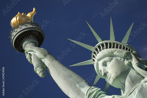 Close-up Portrait of Statue of Liberty Bright Blue Sky Torch