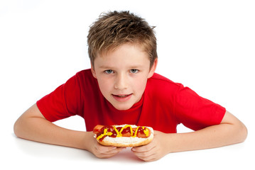 Handsome Young Boy Eating a Hotdog