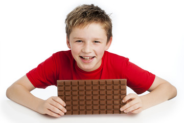 Boy Eating Huge Chocolate Bar