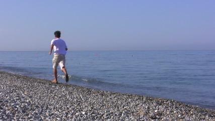 The man runs on the seashore