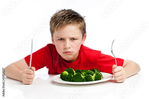 Handsome Young Boy Eating Broccoli