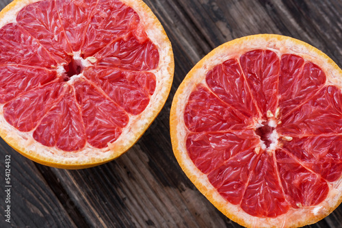 red grapefruit on old table