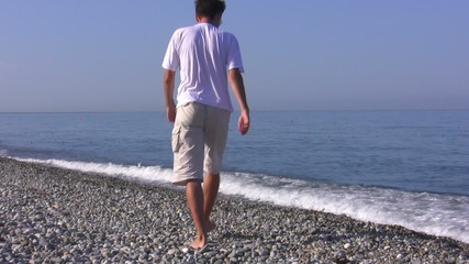 The man walk on a seaside