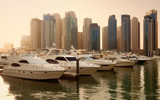 Skyscrapers and Yachts in Dubai Marina During Sunset