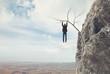 man climbs a mountain