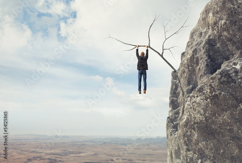 man climbs a mountain