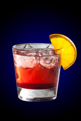 Cocktail with grenadine juice and lemon