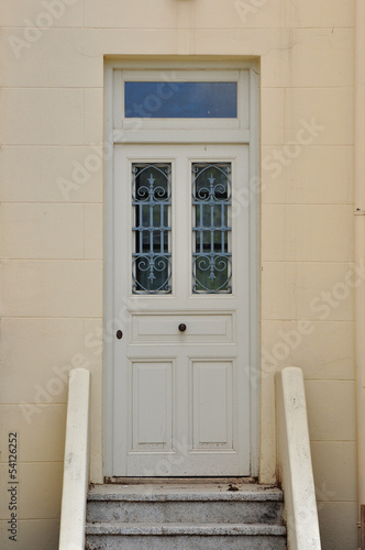wooden door with iron pattern