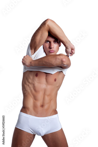 Attractive young man shows pumped up torso