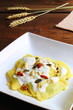 Ravioli with cheese sauce and nuts