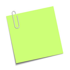 Green sticky note clipped with a paperclip