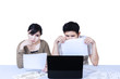 Couple sad looking at laptop - isolated