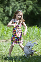 Young girl dropping a puppy