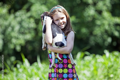 Young girl holding  puppy