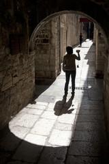Young girl in narrow mediterranean street in Split, Croatia