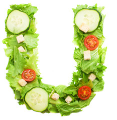 U letter made with salad isolated on white