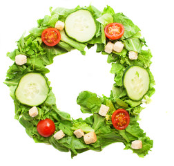 Q letter made with salad isolated on white