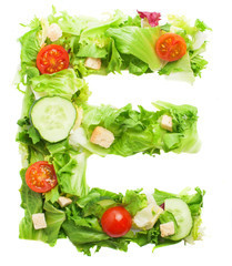 E letter made with salad isolated on white