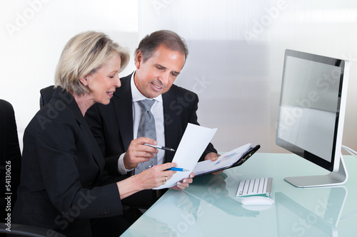 Mature Businessman And Businesswoman Planning