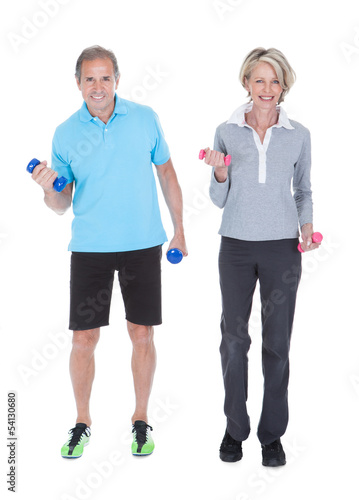 Mature Couple Doing Exercising With Dumbbells