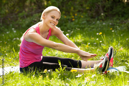 Happy Woman Stretching In Park