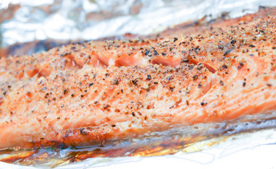 Grilled salmon in aluminum towards white