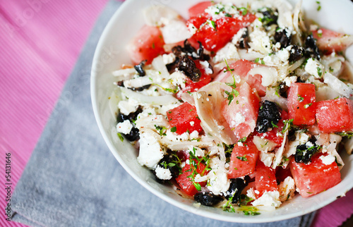 Watermelon salad with feta cheese, olives, onion and thyme