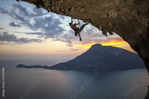 Male rock climber at sunset. Kalymnos Island, Greece